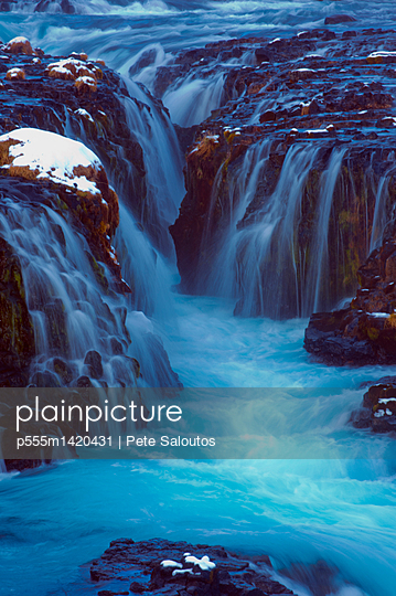 Waterfall flowing over cliff, Bruarfoss, Sudhurland, Iceland - p555m1420431 by Pete Saloutos