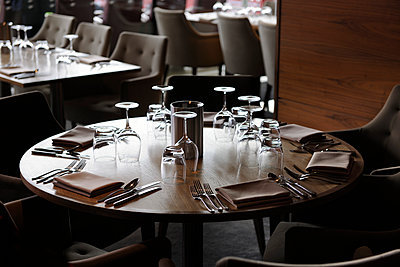 Restaurant table set for lunch - p1048m1123506 by Mark Wagner