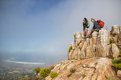 Young couple mountain hiking - p1355m1574154 by Tomasrodriguez