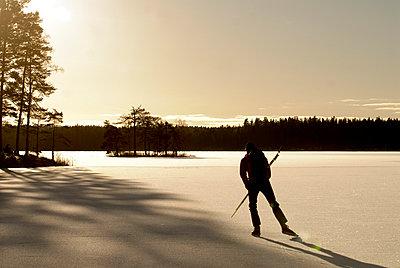 A skater against the light Ostergotland Sweden. - p5751261f by Fredrik Schlyter