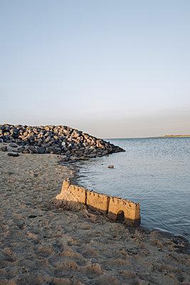 Sand castle on beach - p586m1215233 by Kniel Synnatzschke