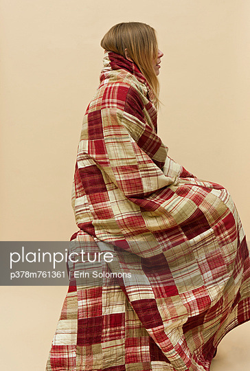 Side of woman in quilt - p378m761361 by Erin Solomons