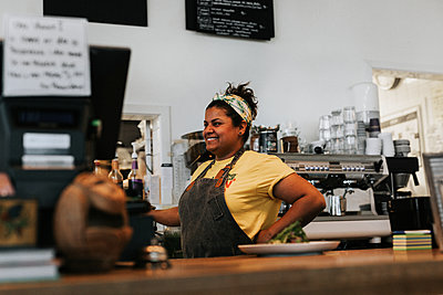 Woman working in cafe - p312m2191302 by Jennifer Nilsson