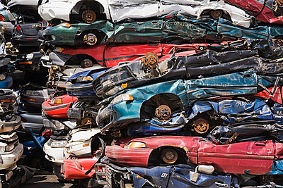 Stacks of crushed cars - p9243811f by Image Source