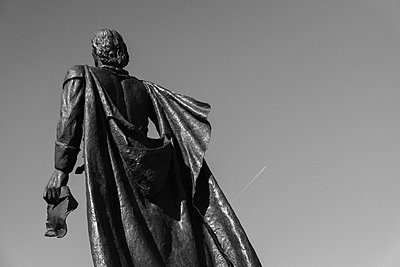 Low angle view of Christopher Columbus statue against clear sky - p301m1029483f by Michael Mann