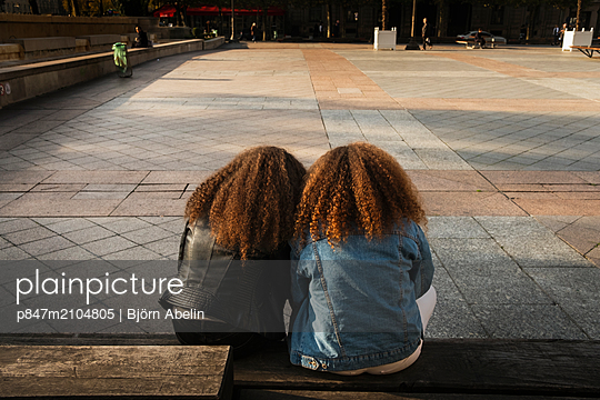 Two Girls Sitting Together   - p847m2104805 by Björn Abelin