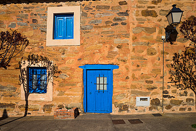 Stone house with blue front door and blue windows - p1165m1441844 by Pierro Luca