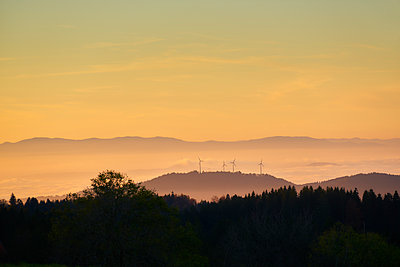 Windmills in twilight  - p1312m1502244 by Axel Killian