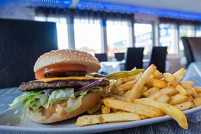 Burger and fries - p1418m1488505 by Jan Håkan Dahlström
