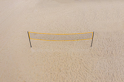 Aerial view of a volleyball net on the beach - p1596m2192877 by Nikola Spasov