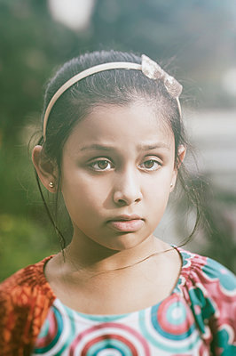 Little girl looking away - p794m966722 by Mohamad Itani