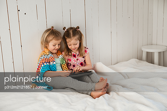 Girls using digital tablet - p312m2121857 by Johner