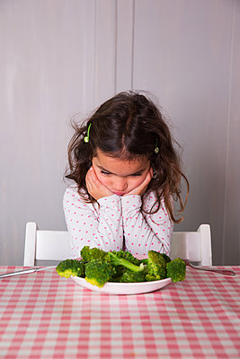 Girl dislikes vegetables - p1231m1209058 by Iris Loonen