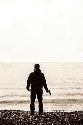Man With Gun - p975m954185 by Hayden Verry