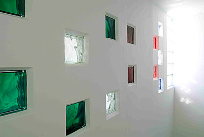 White wall with color glass bricks - p349m790774 by Polly Eltes