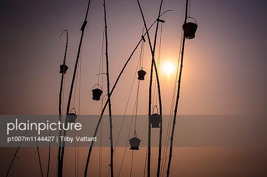 Fishermen baskets and bamboo sticks in the sky - p1007m1144427 by Tilby Vattard