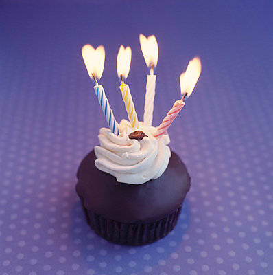 Cupcake with candles - p4950191 by Jeanene Scott