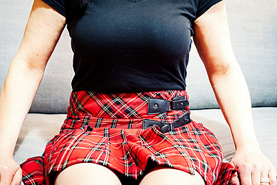 Woman in chequered skirt - p1168m1132627 by Thomas Günther
