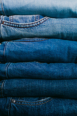 Stack of folded jeans - p1427m2109928 by Alexandra C. Ribeiro