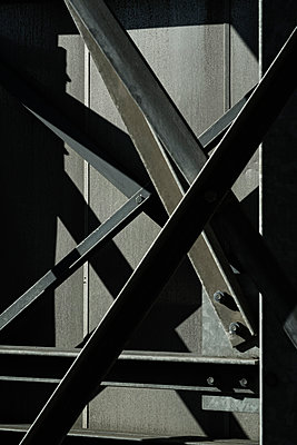 Abstract view of steel beams on rear of bridge - p301m960784f by Michael Mann