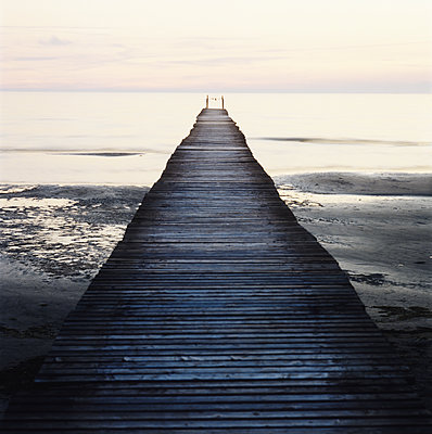 View Of Jetty Leading Towards Sea, Scania, Sweden  - p847m1529403 by Mikael Andersson