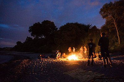 Beach party with campfire - p1142m1362262 by Runar Lind