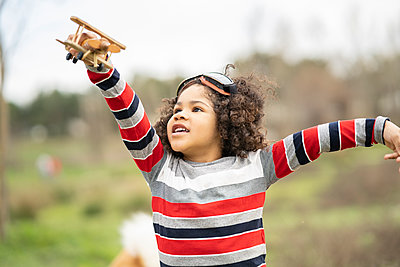 Cute boy playing with wooden toy airplane - p300m2266420 by Jose Carlos Ichiro
