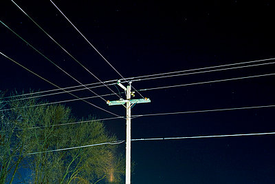 Utility pole at night - p3721752 by James Godman
