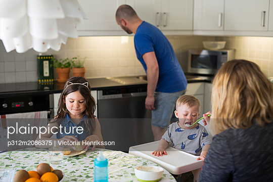 Family having meal together - p312m2086375 by Victoria Henriksson