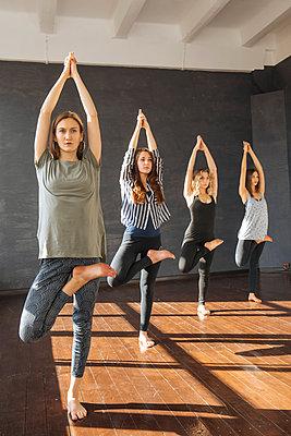 Women during yoga class - p1427m2110115 by Ivan Ozerov