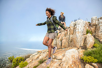 Young couple on mountain peak - p1355m1574151 by Tomasrodriguez