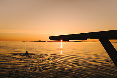 Silhouette of springboard at sunset - p312m2217130 by Stina Gränfors