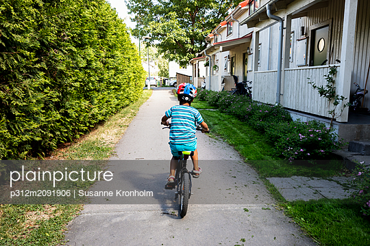 Boy cycling - p312m2091906 by Susanne Kronholm