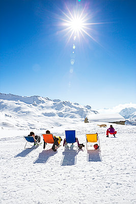 Friends sunbathing in mountains - p312m971075f by Lena Granefelt