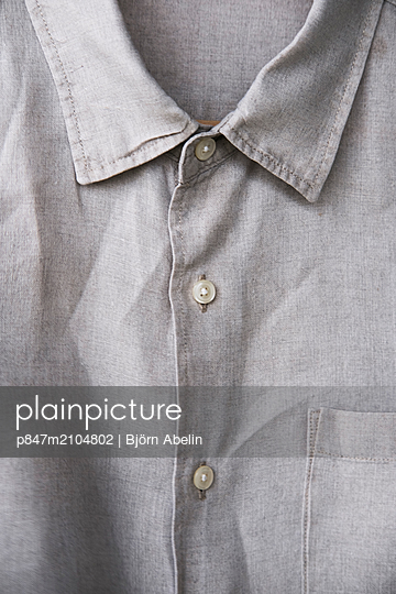 Close-up Of A Gray Shirt   - p847m2104802 by Björn Abelin