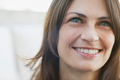 Close-up of smiling mid-adult woman. - p328m784118f by Hero Images