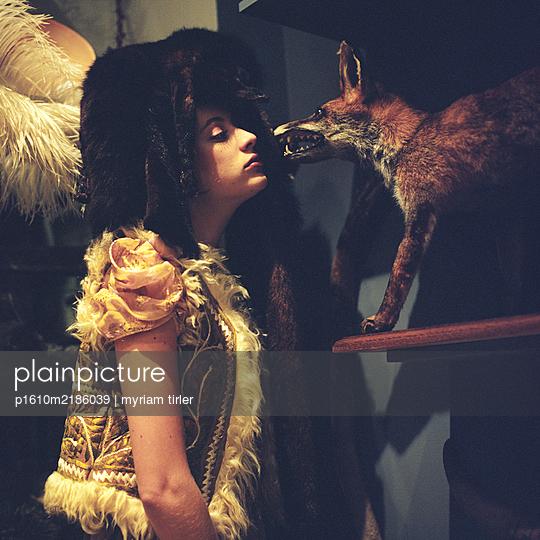 girl with a stuffed fox - p1610m2186039 by myriam tirler