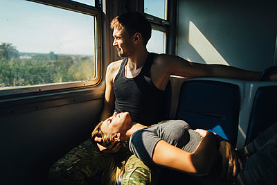 Young couple in train - p1427m2200185 by Kateryna Soroka