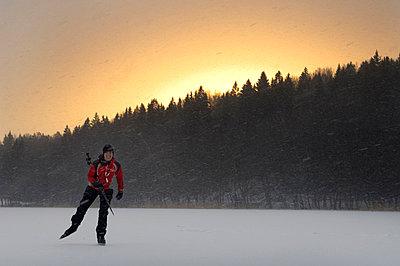 A long distance skater on a frozen lake, Sweden. - p5754797 by Hans Berggren
