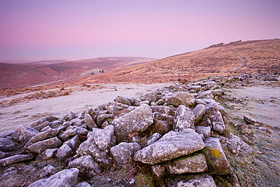 Frost coats the circular stone perimeter wall of the Bronze Age settlement of Grimspound in Dartmoor National Park, Devon, England, United Kingdom, Europe - p8713016 by Adam Burton