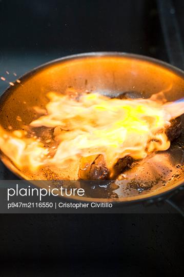 Flambé beef - p947m2116550 by Cristopher Civitillo