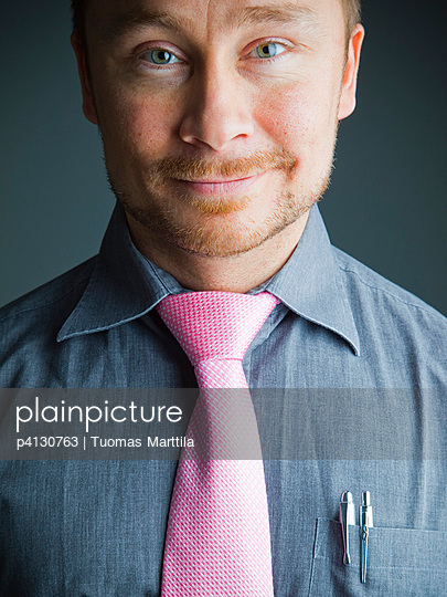 Business man with pink tie - p4130763 by Tuomas Marttila
