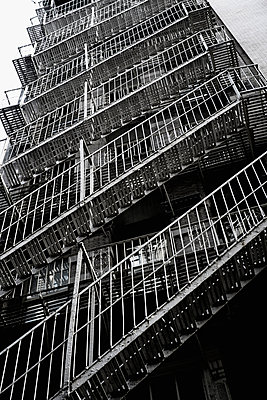 Fire escape steps on rear of building in Manhattan, New York, USA - p301m960799f by Michael Mann