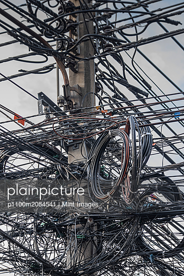 Close up of coiled power lines on pole,Bangkok, Bangkok, Thailand - p1100m2084541 by Mint Images