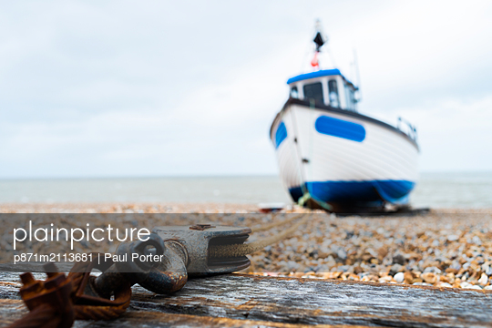 Fishing boat anchored to the block and tackle, Dungeness, Kent, England, United Kingdom - p871m2113681 by Paul Porter