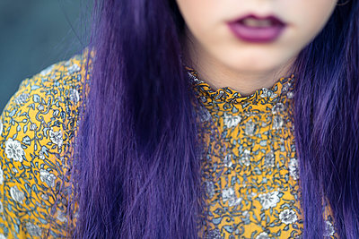 Woman with purple hair in blouse with floral design - p1569m2195798 by Moritz Metzger