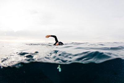 Man swimming alone in sea - p300m2243023 by Josep Rovirosa