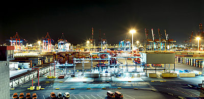 Container port at night - p416m1060503 by Oliver Heinemann