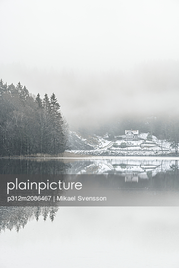 Winter landscape with lake - p312m2086467 by Mikael Svensson