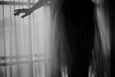 Caucasian teenage girl wearing gauzy skirt - p555m1306063 by Vladimir Serov